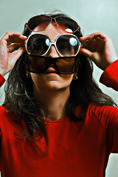 Emanuela Franchini  conceptual self portrait with plenty of sun glasses